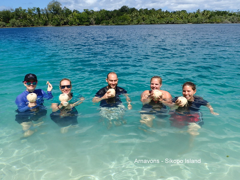 Ex-pat Guests enjoy coconut water in the tepid sea